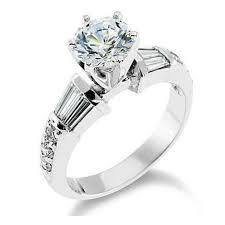 beveled engagement ring style channel set baguette and pave mounted beveled