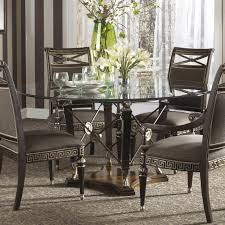 round glass dining table with black wooden base also black leather