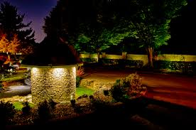 Landscape Lighting Wall Wash - neighborhood entry and landscape lighting make for a warm welcome