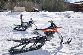 motocross dirt bike games new event at winter xgames mixes motocross with snowmobiles