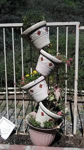 221 best tipsy u0026 stacked pots images on pinterest gardening