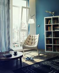 amazing blue white reading space with comfortable chair and lamp