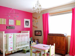 cool nursery for girls with pink wall and curtain with white bed