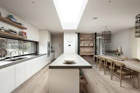 concrete countertops long kitchen island with seating lighting
