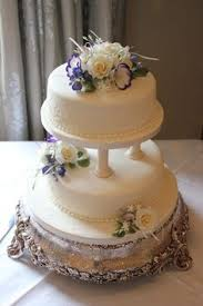 3 tier wedding cake with pillars hand piped lace and hand made