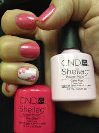 summer shellac color pink with accent nail in cake pop and