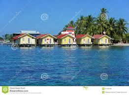 tropical cabins over water of the caribbean sea stock photo