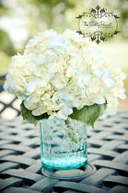 love the white hydrangeas in this with the tint of blue with the