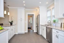 stunning white color wooden shaker kitchen cabinets with white