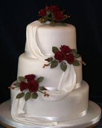 melanie ferris cakes news three tier cake with drape and red roses