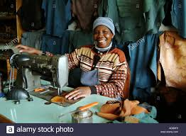 henties bay namibia southern africa leather worker uses sewing