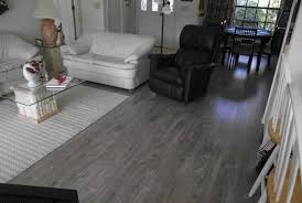floor and decor laminate grey laminate flooring in living room with black and white