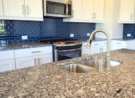 decorative blue glass tile backsplash on kitchen with jasper