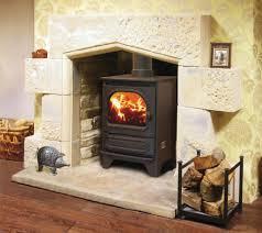 retro sandstone fireplace by artisan fireplace design