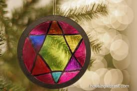 stained glass ornaments housing a forest