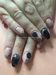 gellux blush and black gel polish with freehand nail art and