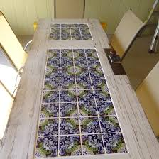 diy mosaic tabletop ideas with flower pattern and white framing
