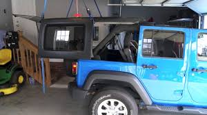 jeep wrangler 2 door hardtop lifted how to install your jeep wrangler 4 door hard top simple hoist