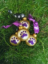 paw print ornaments twelve purple glitter paw prints on gold