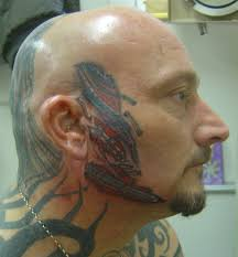 biomechanical tattoo face colored biomechanical tattoo on face