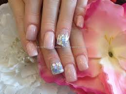 full set of acrylic nails with glitter discs on ring and pinky
