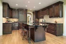 modern oak cabinets with dark wood floors matching kitchen