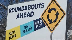 marion puts up billboards to help people navigate their roundabouts