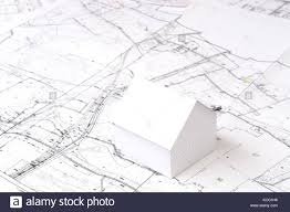 little house building plans white little cardboard house model on building plan stock photo