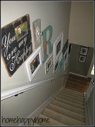 Staircase Wall Design by Basically How To Put Your Photos And Or Various Artwork On Your