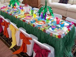 luau party table like the grass skirt with flower trim palm