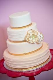 simply elegant three tier fondant cake with gold trim gilded