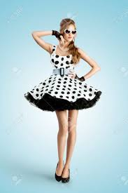 a vintage photo of a beautiful pin up wearing a retro polka