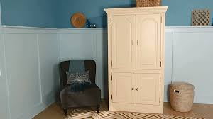 Entertainment Armoire With Pocket Doors Revamped Armoires For Small Space Storage With A New Look