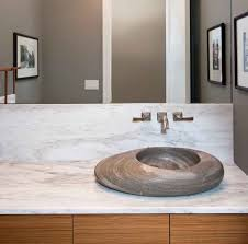modern powder room sink sculptural stone bowl sink on a marble