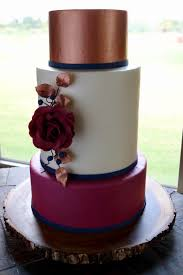 rose gold and burgundy wedding cake with handmade sugar rose