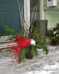Outdoor Christmas Decorations Urns by How To Fill Outdoor Planters For The Holidays The Interior