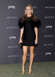 gwyneth paltrow rocks black dress with sequined neck