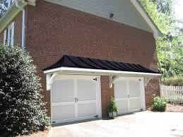 metal roof portico over double garage doors designed and built by metal roof portico over double garage doors designed and built by georgia front porch