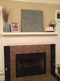 shiplap and herringbone tile fireplace renovation