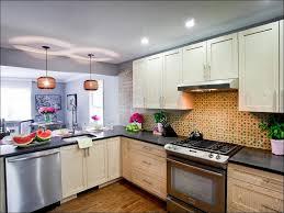 kitchen beige kitchen cabinets red kitchen walls dark wood floor