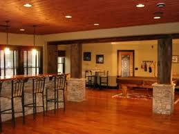 rustic finished basement theme with natural wood pillars and and