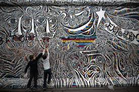 photos the berlin wall today us news berlin wall at niederkirchnerstrasse children play in front of the painted east side gallery the largest part of original
