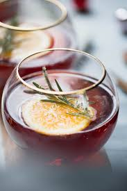 orange champagne mimosa with candied rosemary