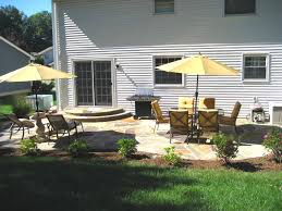 creative flagstone patio installation on backyard landscaping with