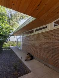 house 50 50 shelters indoor and outdoor space beneath its roof
