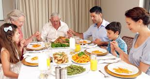 tracks across table as extended family sit and enjoy
