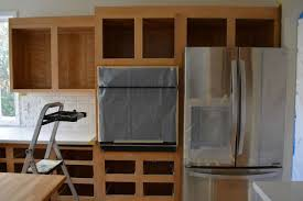 how to refinish stained wood kitchen cabinets what we learned from a forever project to refinish kitchen