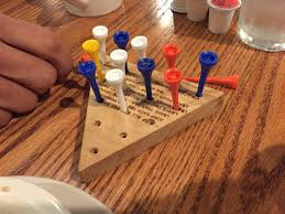 cracker barrel table game you can play games checkers or this game while waiting for table
