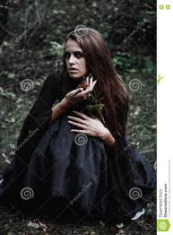 halloween witch in a dark forest beautiful young woman in witches