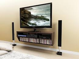 modern family room with floating wall mount console media shelf